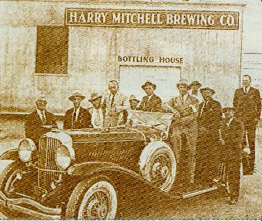 Harry Mitchell (right, on running board).